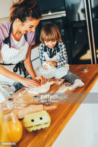 Mother and son making cookies in the kitchen