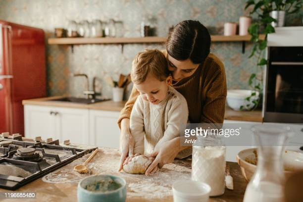 mother and son making cookies - baked stock pictures, royalty-free photos & images