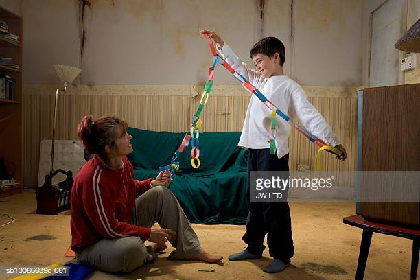 Mother and son making paper chain