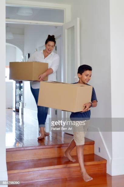 mother and son moving into their new home - rafael ben ari photos et images de collection