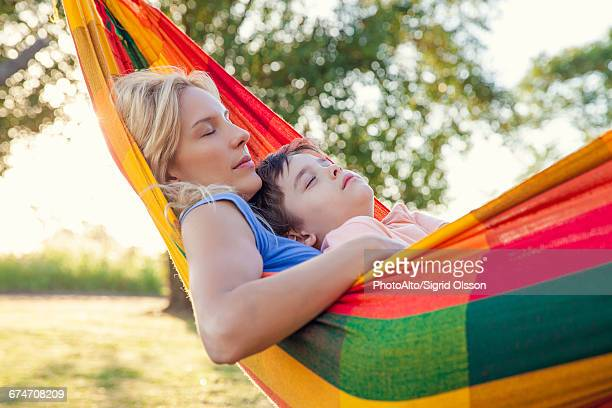 Mother and son napping together in hammock