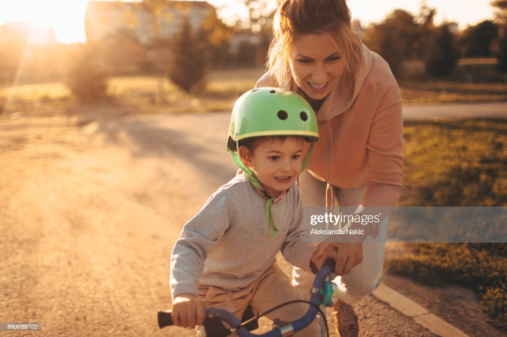 Mother and son on a bicycle lane : Stock Photo
