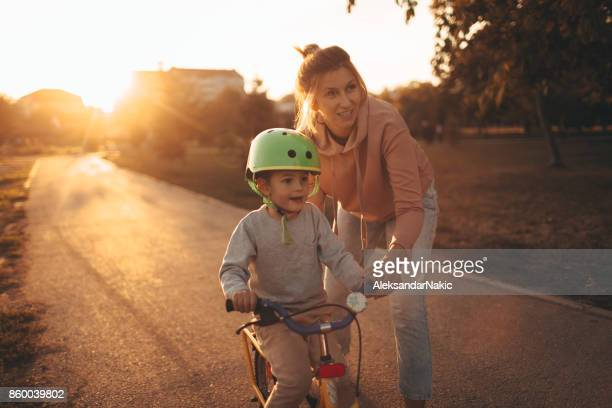 Mother and son on a bicycle lane