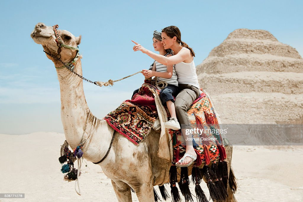 Mother and son on a camel : Stock Photo