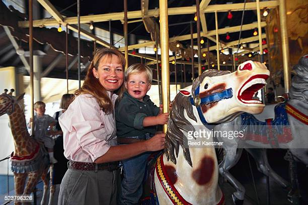 Mother and Son on a Carousel