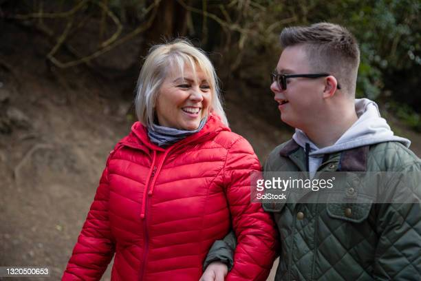 mother and son on a walk - side by side stock pictures, royalty-free photos & images