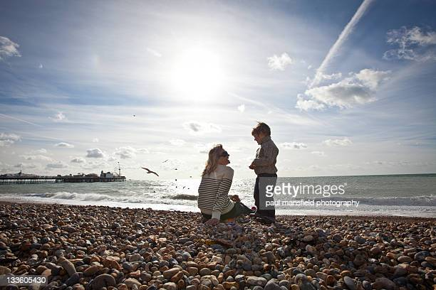 mother and son on brighton beach - mid distance stock pictures, royalty-free photos & images