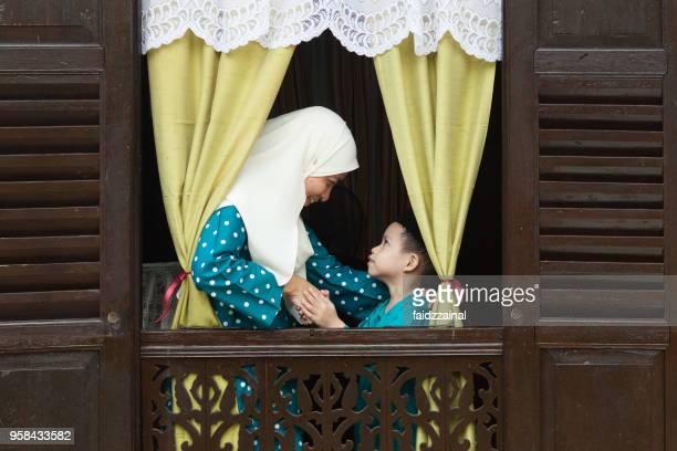 mother and son on eid-ul-fitr/ aidilfitri / hari raya - hari raya celebration stock pictures, royalty-free photos & images