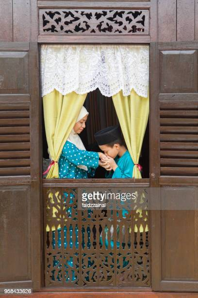 mother and son on eid-ul-fitr/ aidilfitri / hari raya - hari raya stock pictures, royalty-free photos & images