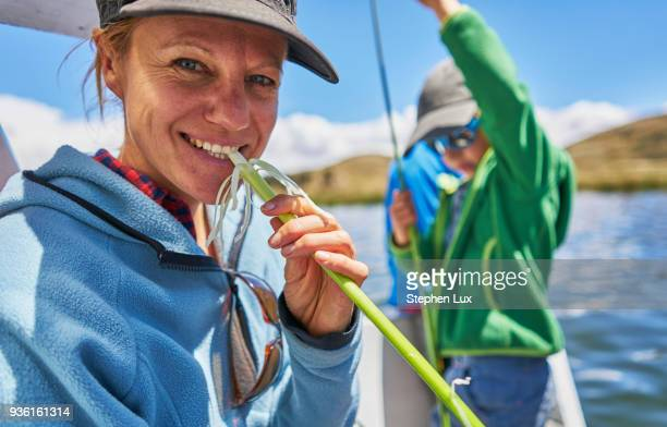 mother and son on fishing boat, huarina, la paz, bolivia, south america - son la stock pictures, royalty-free photos & images