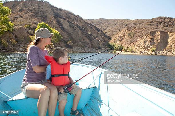 mother and son on fishing trip - castaic lake stock pictures, royalty-free photos & images