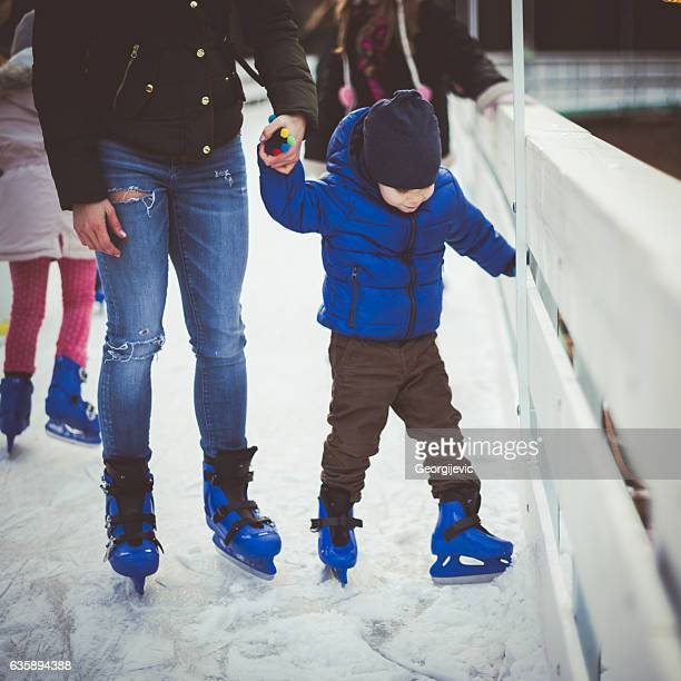 Mother and son on ice skating