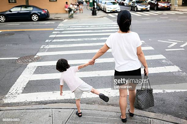 Mother And Son On Street.