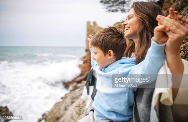 mother and son on the beach, lloret de mar, spain - images fotografías e imágenes de stock