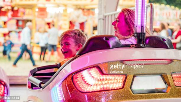 Mother and Son on the Dodgems at the Fairground