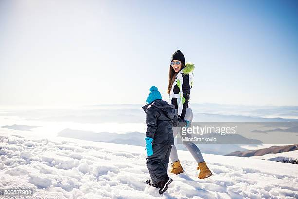 Mother and son on the top of mountain