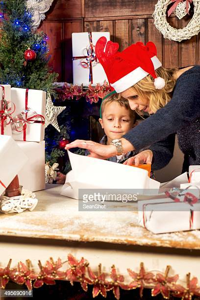 Mother and Son Packing Christmas Boxes