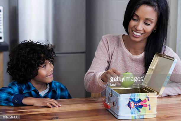 Mother and son packing lunch box