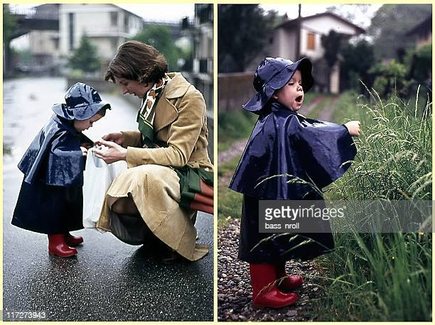 mother and son - vintage raincoat stock photos and pictures