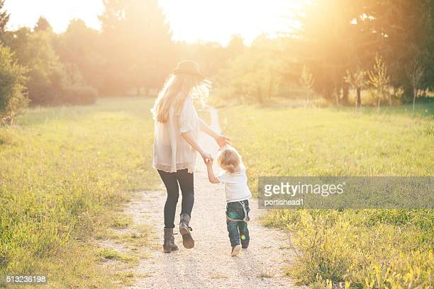 mother and son - golden hour stock pictures, royalty-free photos & images