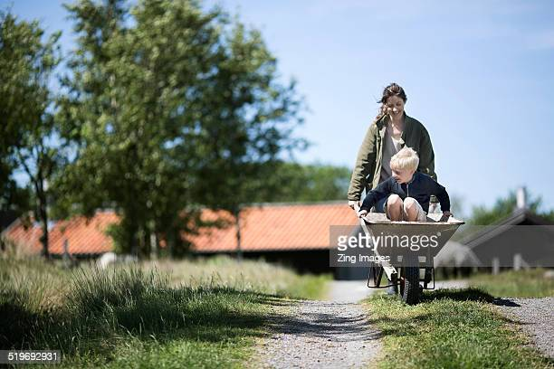 mother and son - rural scene stock pictures, royalty-free photos & images
