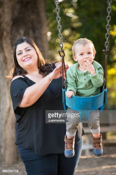 mother and son - arab women fat stock pictures, royalty-free photos & images