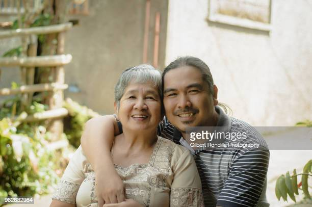 mother and son - filipino culture stock pictures, royalty-free photos & images