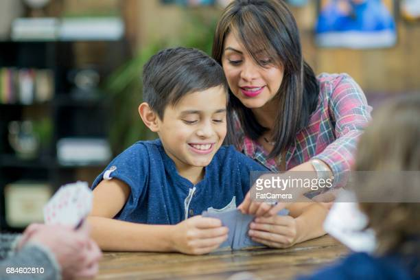 Mother and Son Play Cards Together