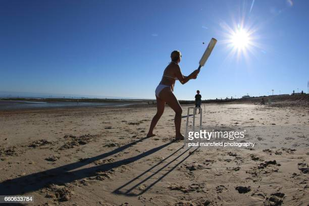 mother and son play cricket on the beach - beach cricket stock pictures, royalty-free photos & images