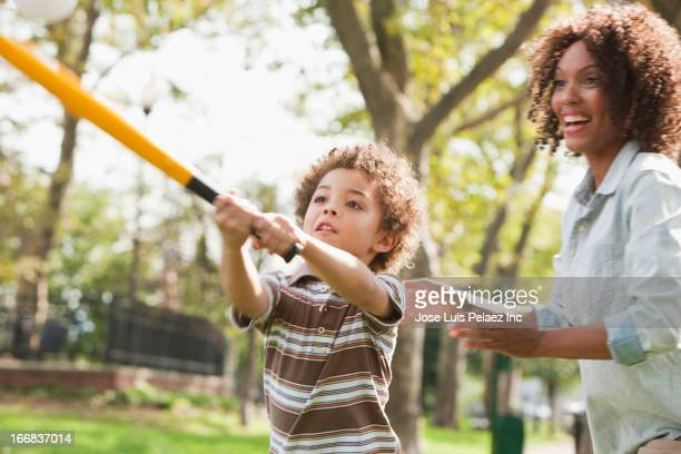 mother and son playing baseball in park - baseball sport stock pictures, royalty-free photos & images