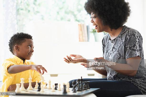 Mother and son (6-7) playing chess