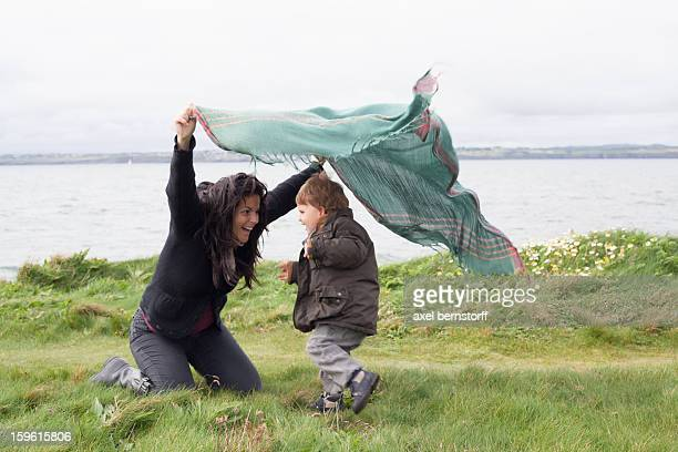 Mother and son playing in grassy field