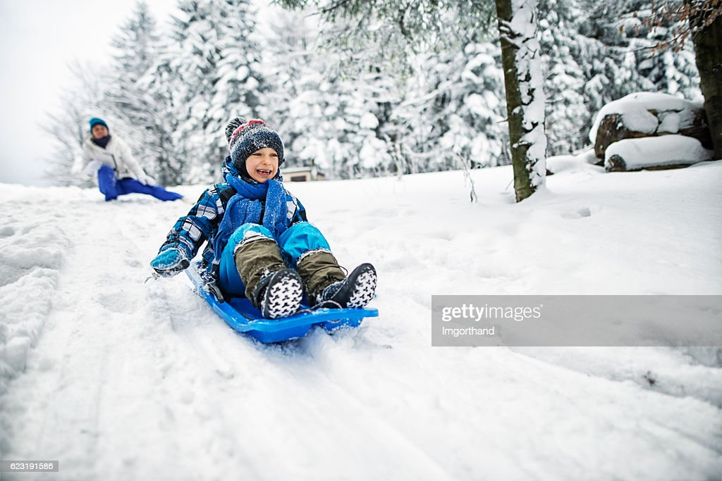 Mother and son playing in snow : Stock Photo