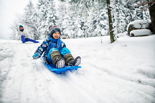 Mother and son playing in snow 623191586