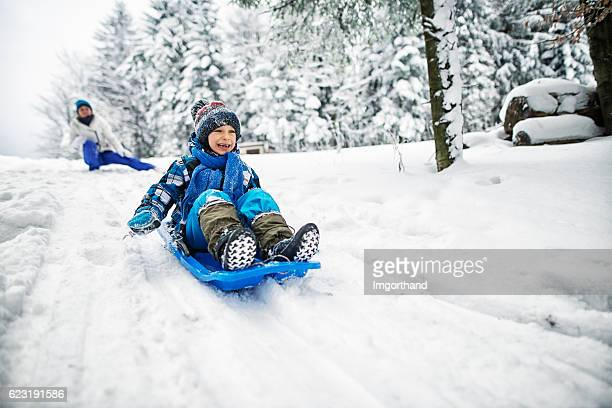 mother and son playing in snow - snow stock photos and pictures