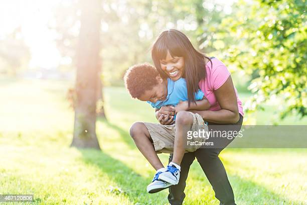 mother and son playing outdoors - black mothers day stock pictures, royalty-free photos & images