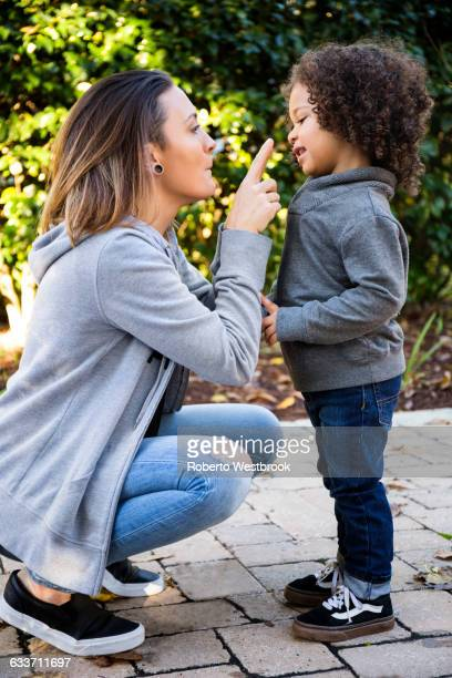mother and son playing outdoors - mother scolding stock pictures, royalty-free photos & images
