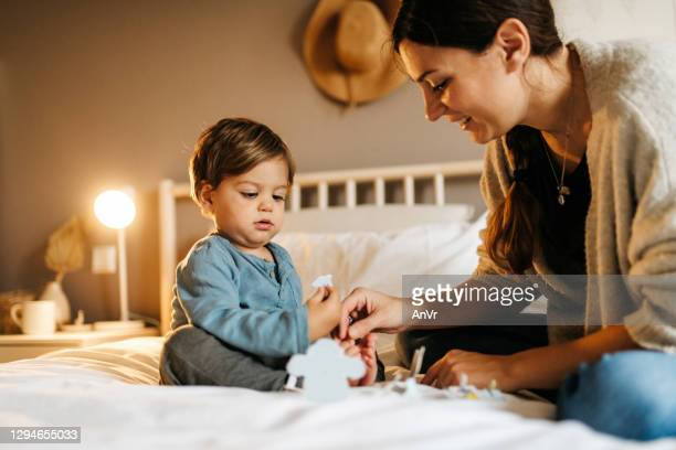 mother and son playing togehter - istock images stock pictures, royalty-free photos & images