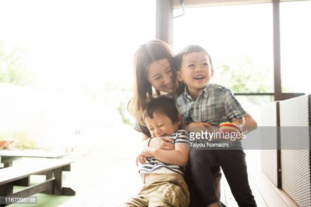 mother and son playing together - asian stock pictures, royalty-free photos & images