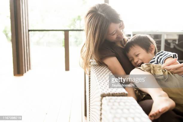 mother and son playing together - two parents ストックフォトと画像