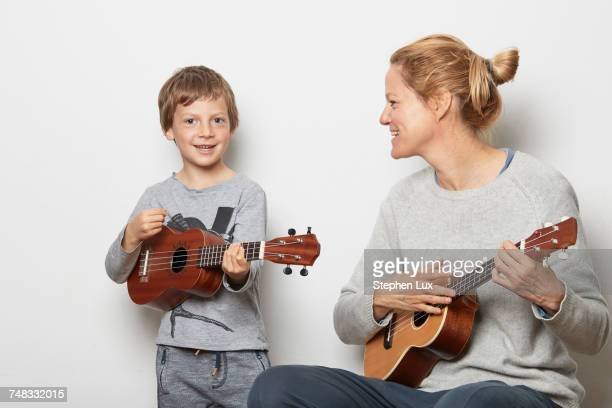 Mother and son playing ukuleles