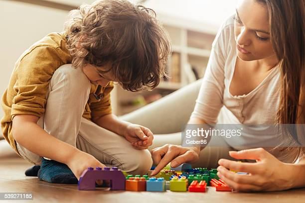 Mother and son playing with colorful blocks