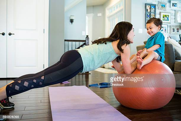 Mother and son playing with exercise ball
