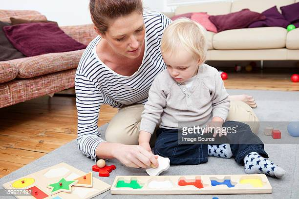 Mother and son playing with puzzle