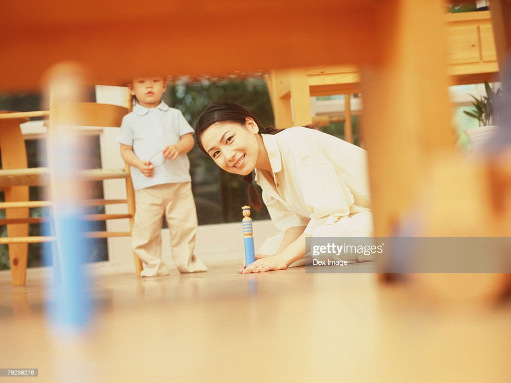 Mother and son playing wooden toy : Stock Photo