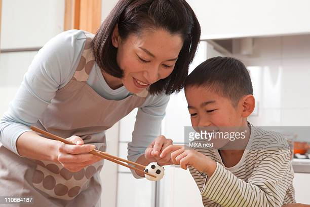 Mother and Son Pointing Rice Ball