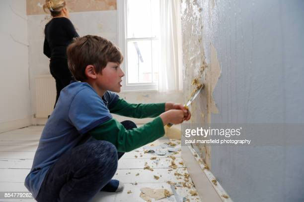 Mother and son preapre to decorate a bedroom