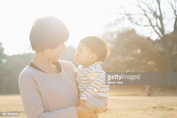 mother and son relaxed in the park - childhood stock pictures, royalty-free photos & images