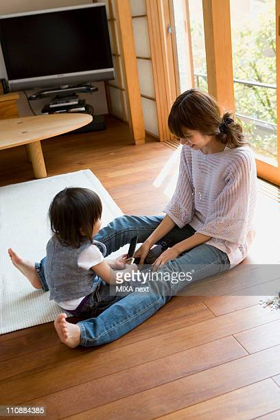 Mother and Son Relaxing at Living Room