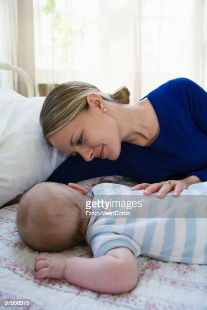 mother and son relaxing - next to stock pictures, royalty-free photos & images